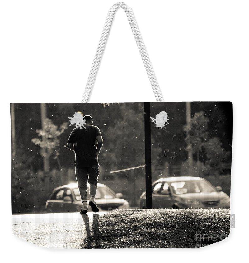 Weekender Tote Bag featuring the photograph Early Morning Jog by Cheryl Baxter