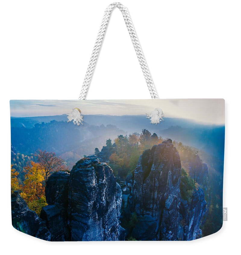 Germany Weekender Tote Bag featuring the photograph Early Morning Mist At The Bastei In The Saxon Switzerland by Sun Travels