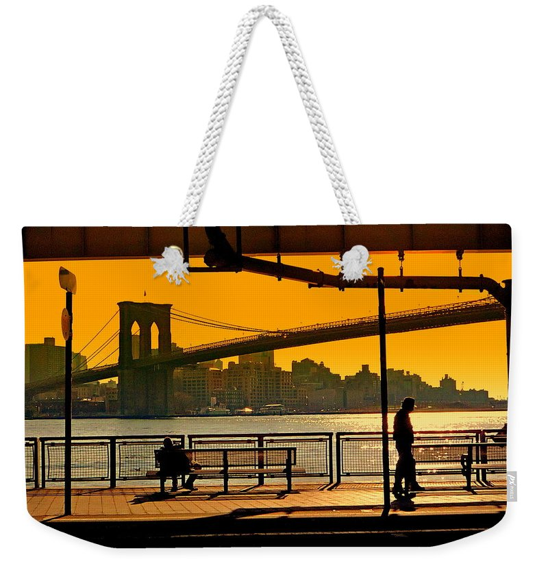 East Weekender Tote Bag featuring the photograph East River Sunset by Valentino Visentini