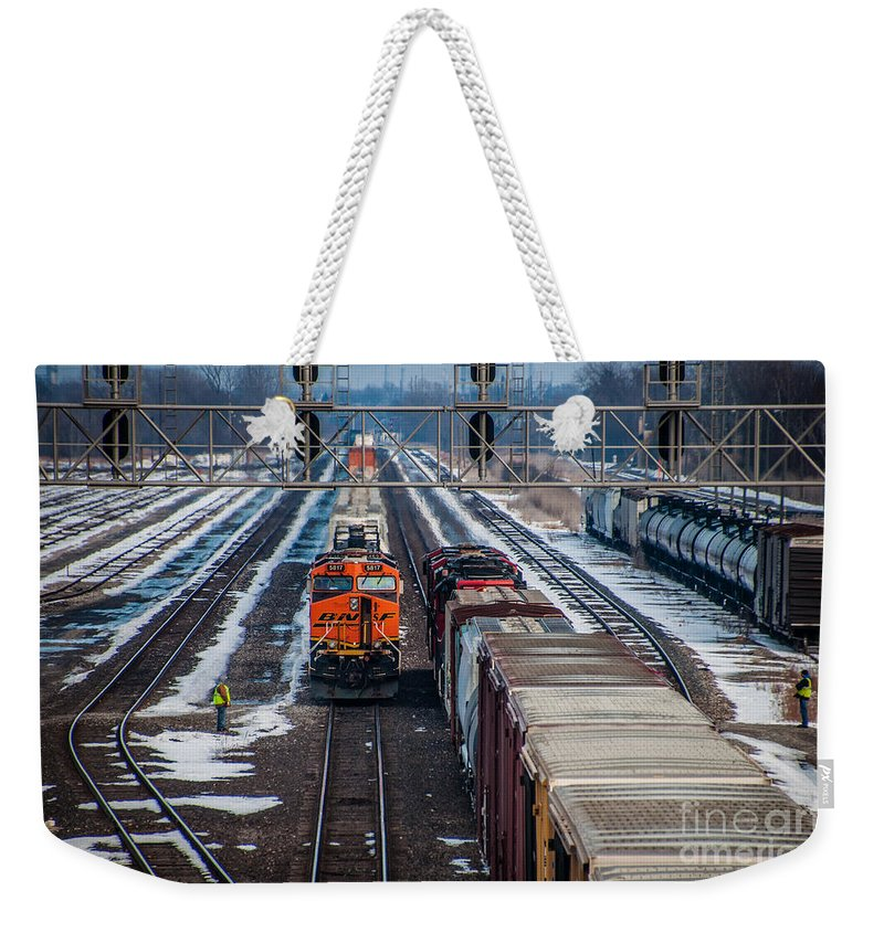 Train Weekender Tote Bag featuring the photograph Eastbound And Westbound Trains by Ronald Grogan