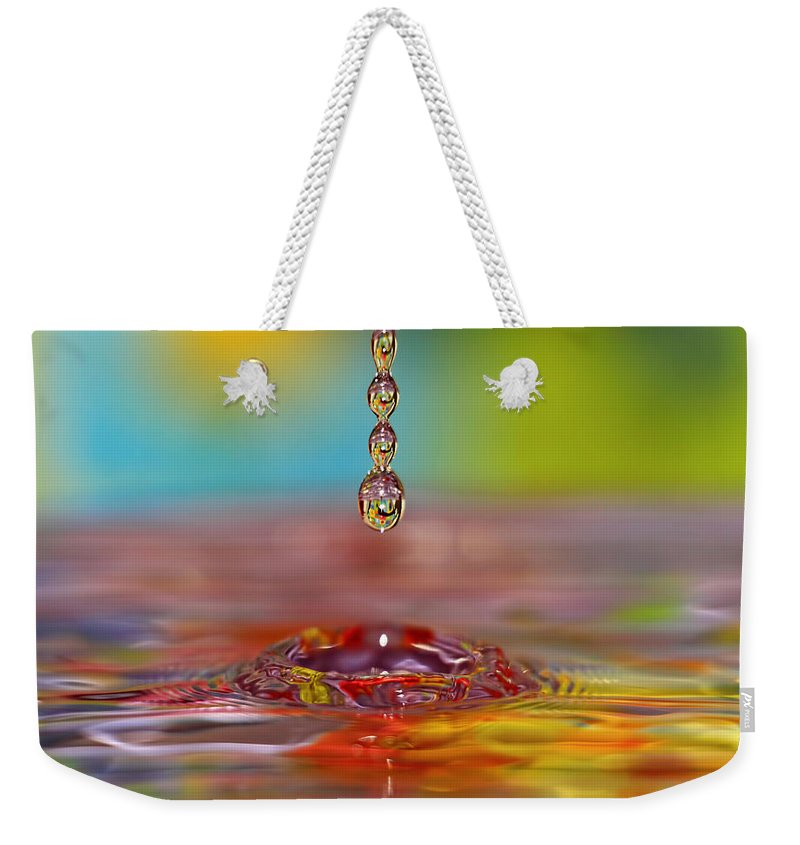 Water Weekender Tote Bag featuring the photograph Easter Drop Water by Geraldine Scull