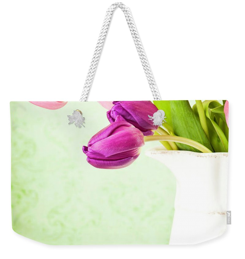 Mother's Day Weekender Tote Bag featuring the photograph Easter Tulips And Copy Space by Catlane
