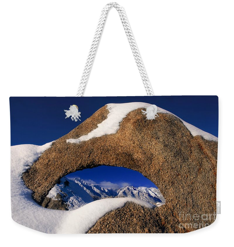 North America Weekender Tote Bag featuring the photograph Eastern Sierras Through Snow Covered Arch by Dave Welling