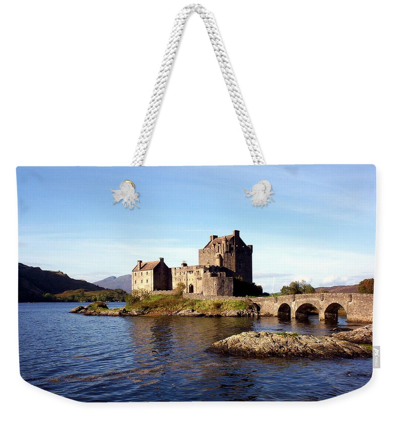 Clan Macrae Weekender Tote Bag featuring the photograph Eilean Donan Castle Kintail Scotland by Rodger Insh