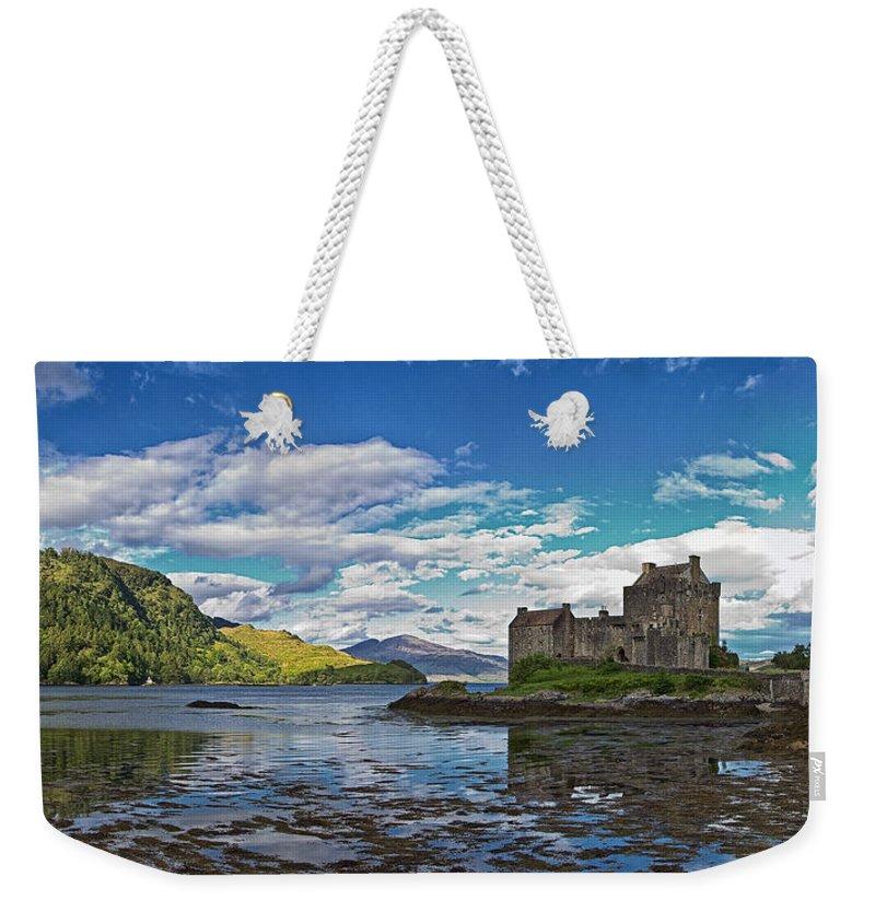 Eilean Weekender Tote Bag featuring the photograph Eilean Donan Castle by David Pringle