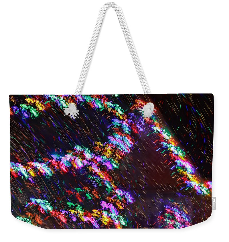 Christmas Weekender Tote Bag featuring the photograph Electric Caterpillar by Gary Holmes