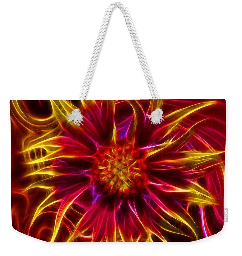 Firewheel Weekender Tote Bag featuring the digital art Electric Firewheel Flower Artwork by Nikki Marie Smith