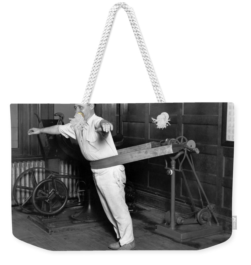 1035-276 Weekender Tote Bag featuring the photograph Electrical Vibrating Machine by Underwood Archives