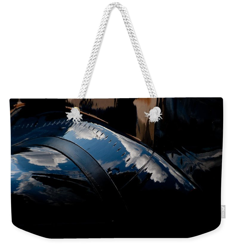 Embraer Phenom 100 Weekender Tote Bag featuring the photograph Embraer Reflection II by Paul Job