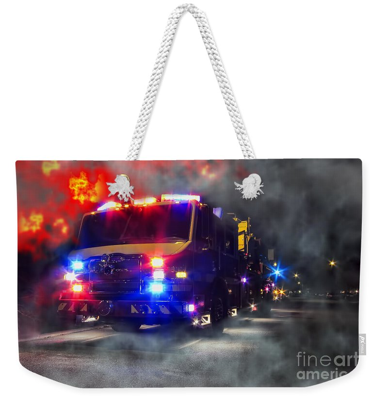 Fire Weekender Tote Bag featuring the photograph Emergency by Olivier Le Queinec