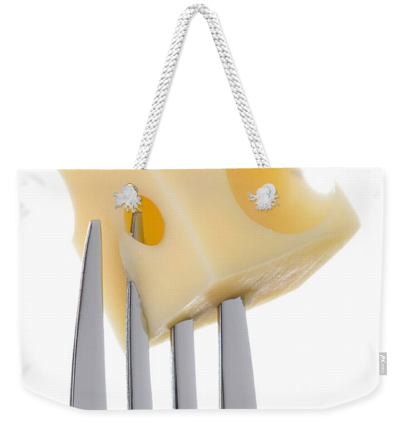 Cheese Weekender Tote Bag featuring the photograph Emmental Cheese On Fork Against White Background by Lee Avison