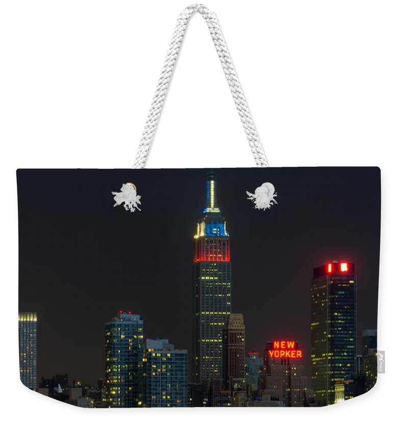 Clarence Holmes Weekender Tote Bag featuring the photograph Empire State Building Lightning Strike I by Clarence Holmes