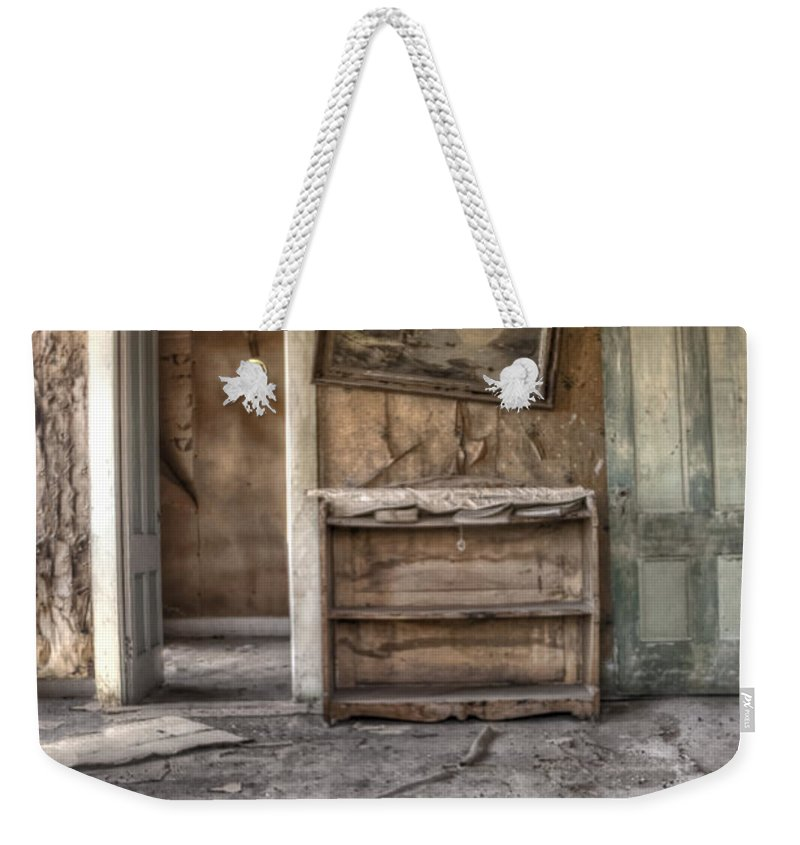 Room; Interior; Empty; Dirty; Grunge; Desolate; Baron; Bare; No One; Deserted; Neglected; Floor; Ceiling; Walls; Door; Doorway; Shelves; Picture; Crooked; Worn; Destroyed; House; Home; Abandoned; Ruins Weekender Tote Bag featuring the photograph Empty by Margie Hurwich