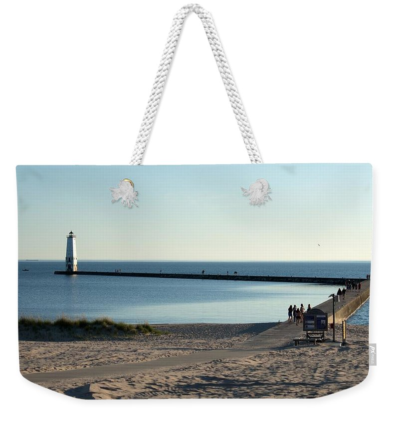 Michigan Weekender Tote Bag featuring the photograph End Of The Pier by Linda Kerkau