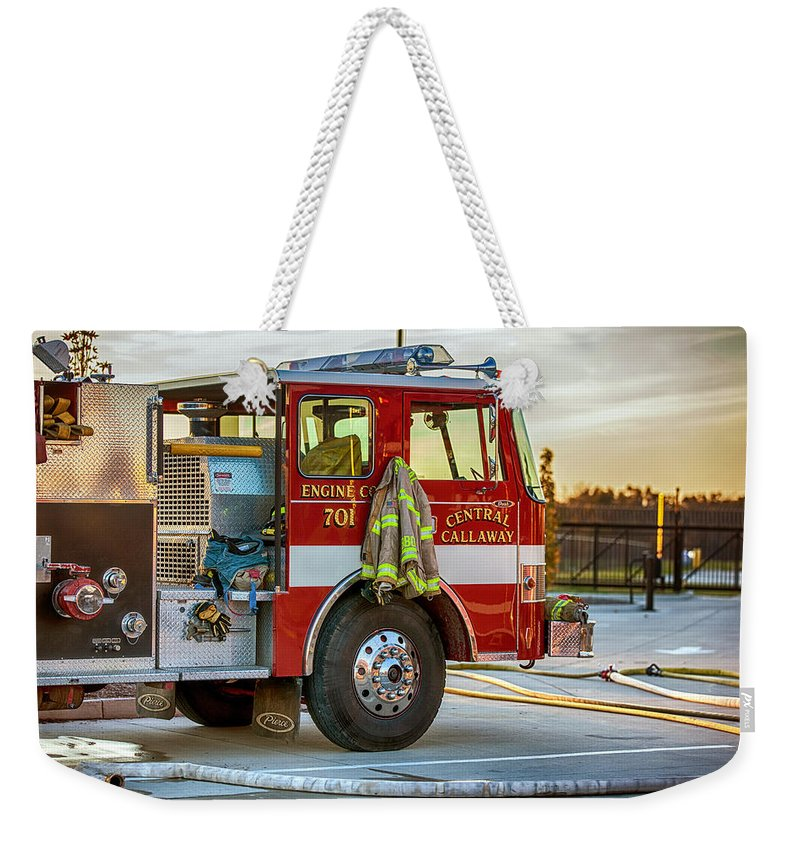 Extinguish Weekender Tote Bag featuring the photograph Engine Company 701 by Sennie Pierson