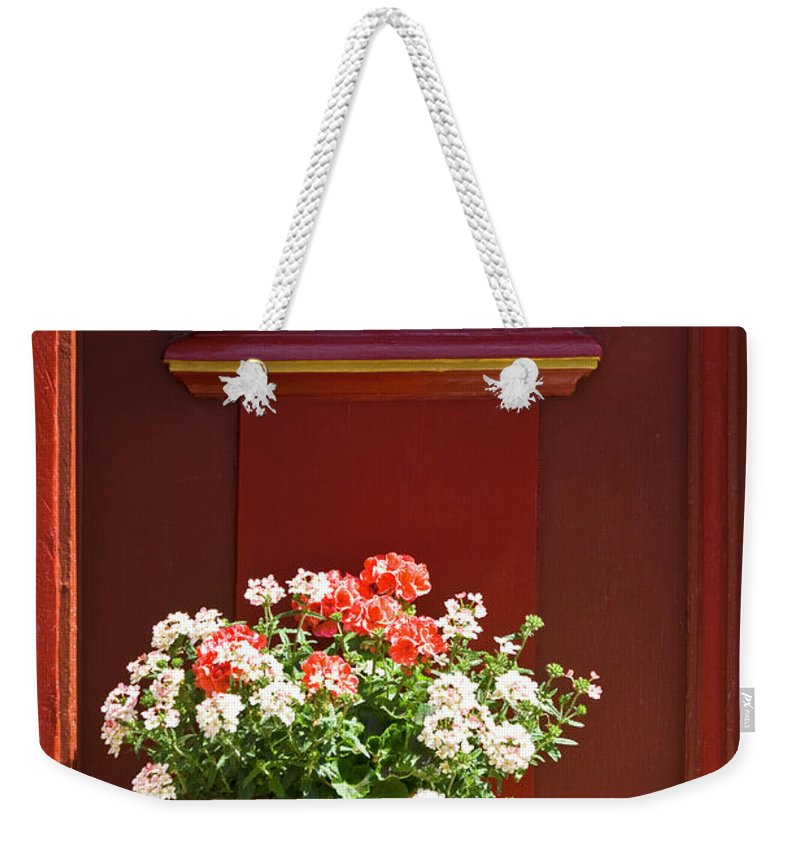 Weekender Tote Bag featuring the photograph Entrance Door With Flowers by Heiko Koehrer-Wagner