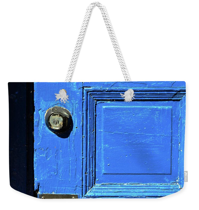 City Weekender Tote Bag featuring the photograph Entrance To Babylon by Bob Orsillo