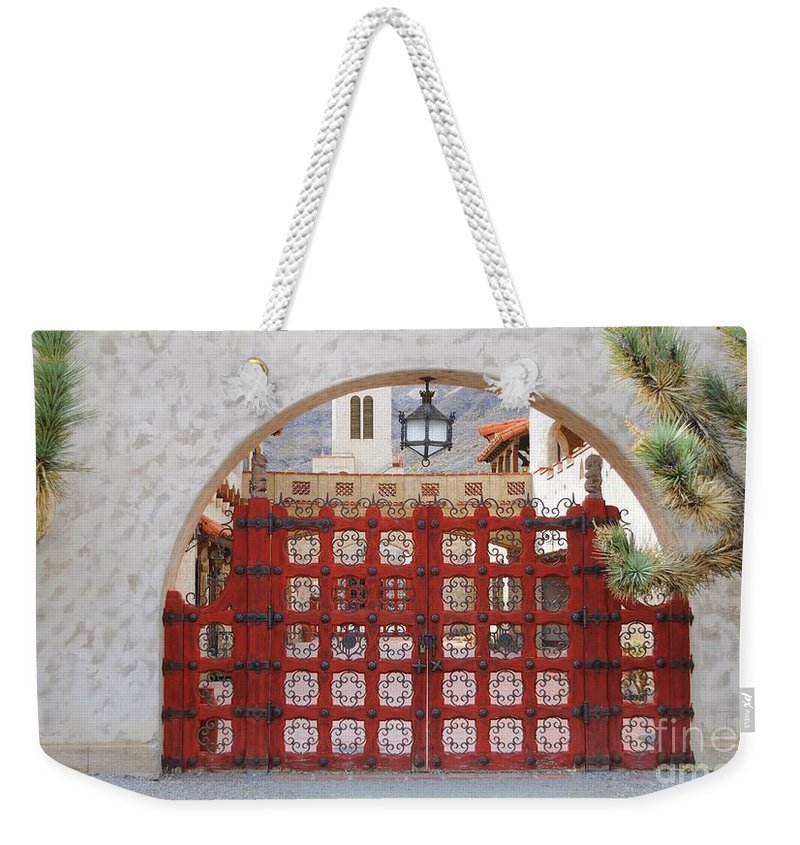 Gate Weekender Tote Bag featuring the photograph Entrance To Court Yard by Kathleen Struckle