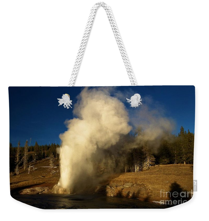 Riverside Geyser Weekender Tote Bag featuring the photograph Eruption Along The Firehole by Adam Jewell