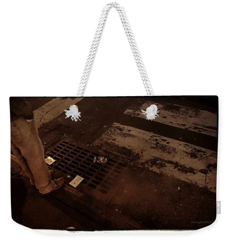 New York Weekender Tote Bag featuring the photograph Escape From New York by Donna Blackhall