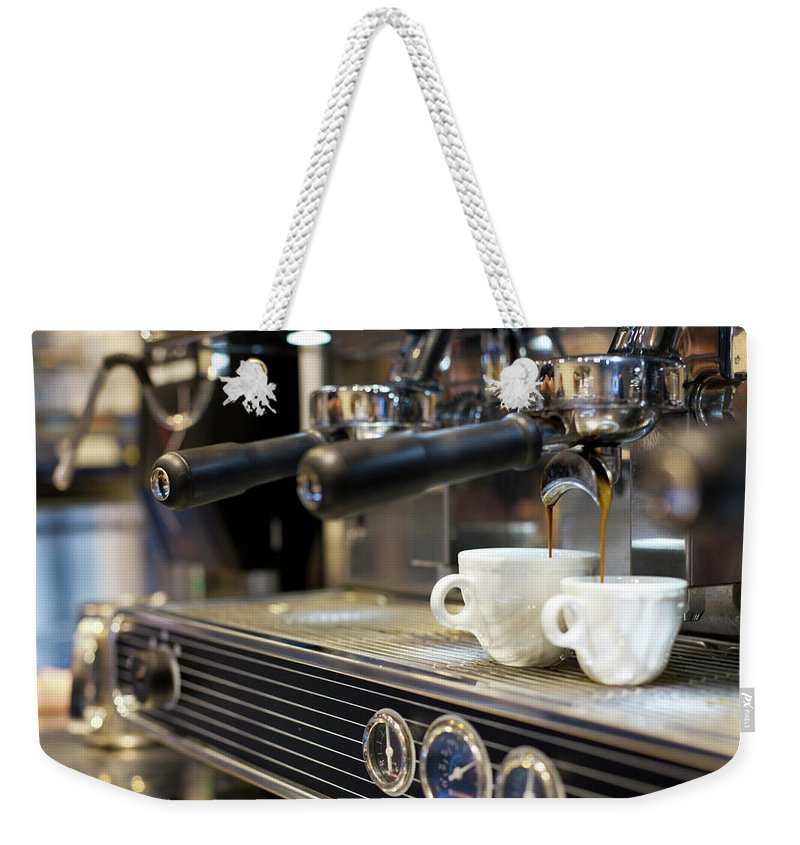 Making Weekender Tote Bag featuring the photograph Espresso Machine Pouring Coffee Into by Kathrin Ziegler