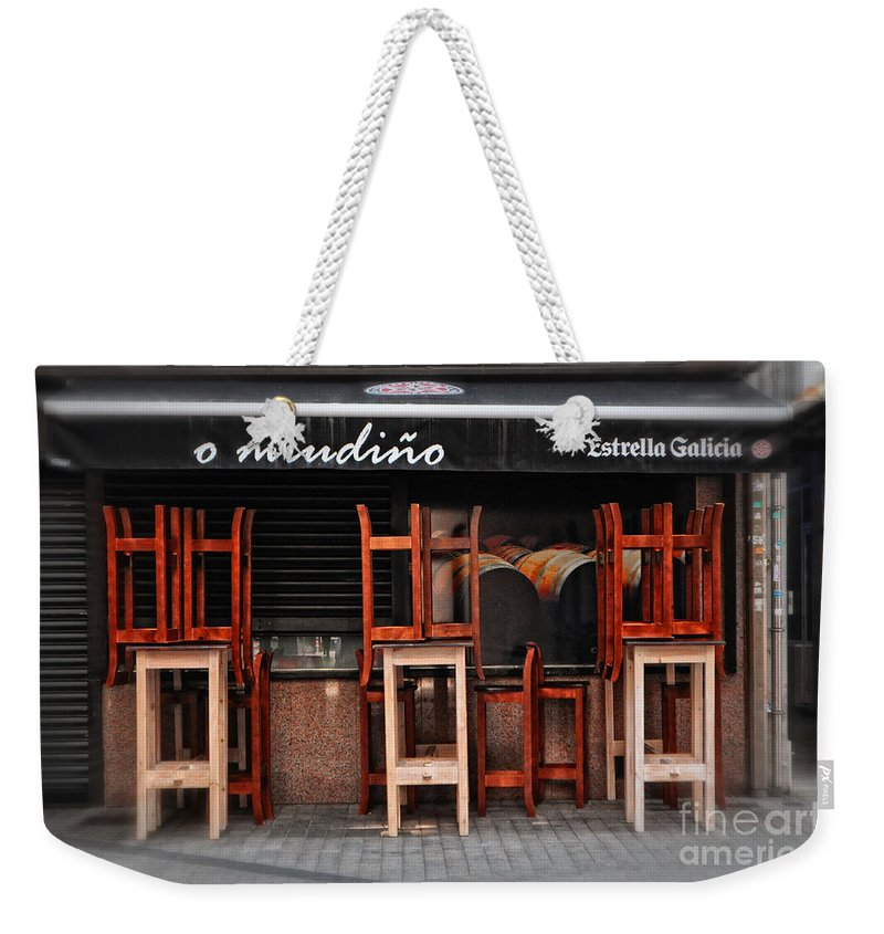 Estrella Galicia Weekender Tote Bag featuring the photograph Estrella Galicia by Mary Machare
