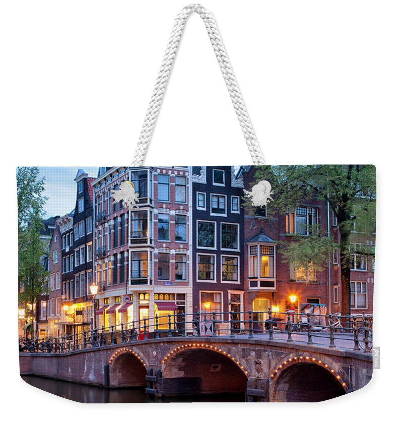 Amsterdam Weekender Tote Bag featuring the photograph Evening In Amsterdam by Artur Bogacki