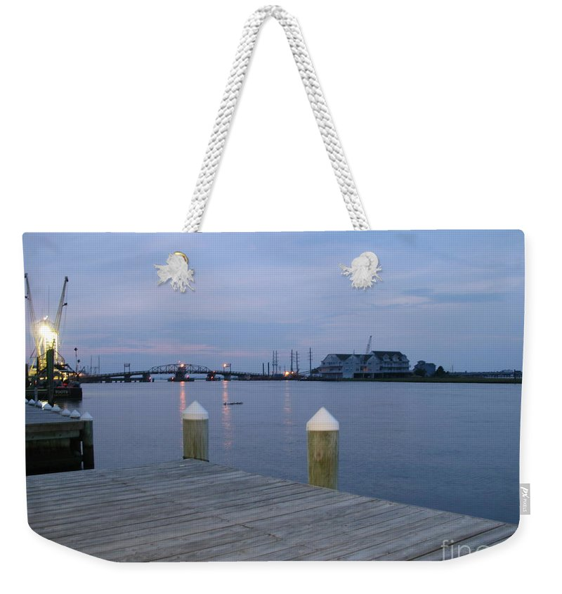 Evening Light Weekender Tote Bag featuring the photograph Evening Light At Chincoteague Sound by Christiane Schulze Art And Photography