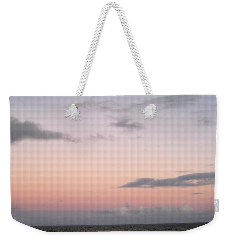 Beach Weekender Tote Bag featuring the photograph Evening Sky by Megan Cohen