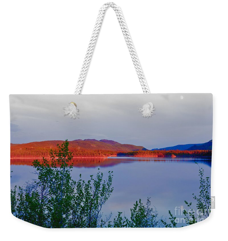 Adventure Weekender Tote Bag featuring the photograph Evening Sun Glow On Calm Twin Lakes Yukon Canada by Stephan Pietzko