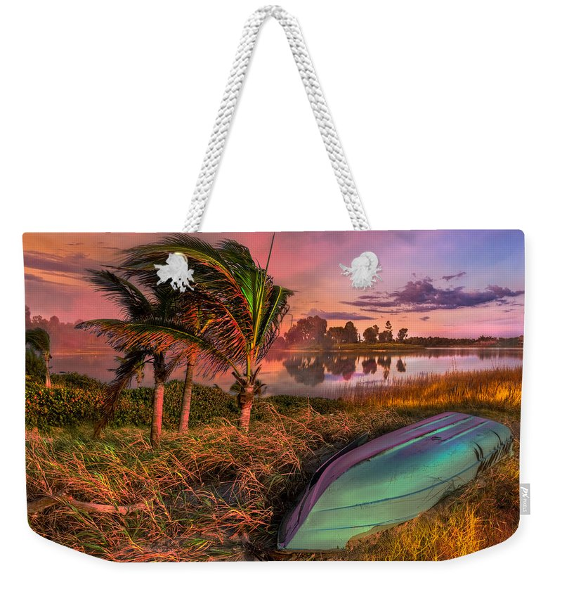 Clouds Weekender Tote Bag featuring the photograph Evening's Kiss by Debra and Dave Vanderlaan