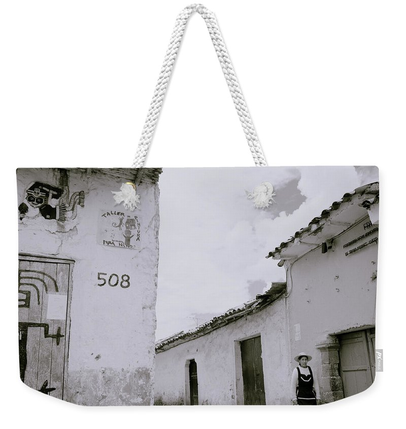 Cuzco Weekender Tote Bag featuring the photograph The Life Of Cuzco by Shaun Higson