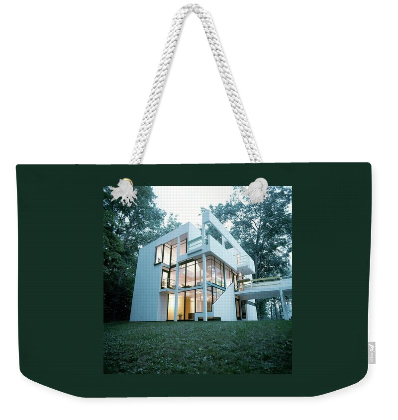 Home Weekender Tote Bag featuring the photograph Exterior Of Mr. And Mrs. Jay Hanslemann's by Tom Yee
