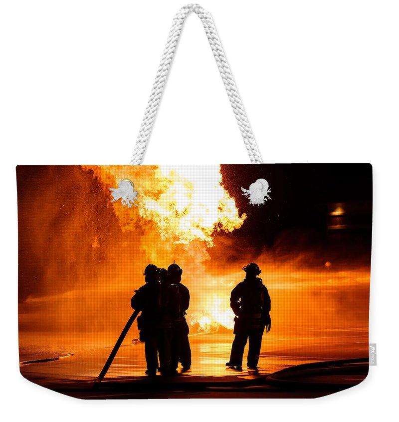 Extinguish Weekender Tote Bag featuring the photograph Extinguish by Sennie Pierson