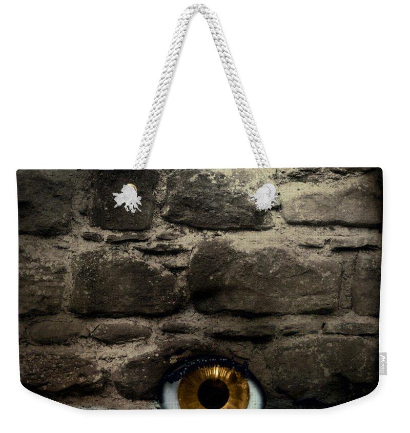 Eye Weekender Tote Bag featuring the photograph Eye In Brick Wall by Amanda Elwell