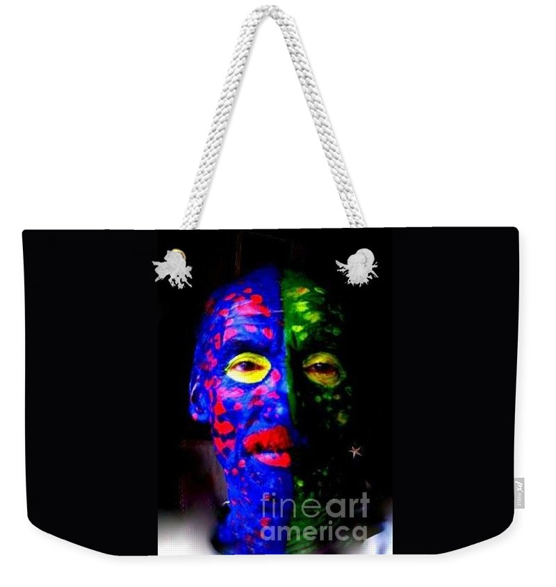 Nola Weekender Tote Bag featuring the photograph Eye See Colors Mardi Gras Hand Painted Face by Michael Hoard