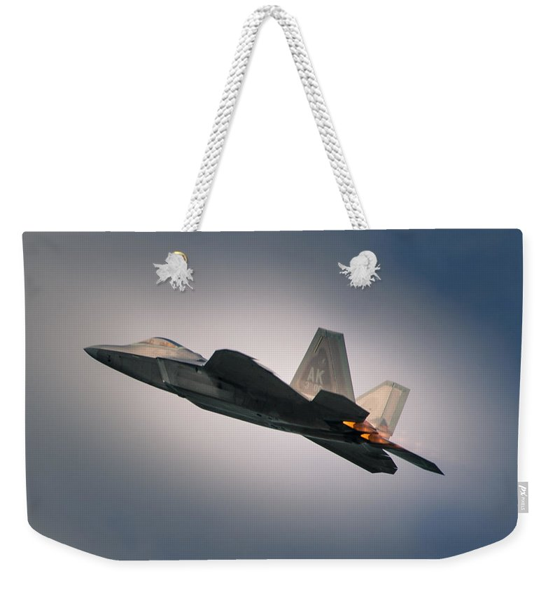 Military Weekender Tote Bag featuring the photograph F-22 by Nikolai Martusheff