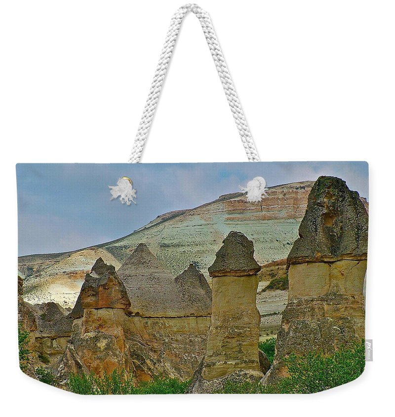Fairy Chimneys In The Making Weekender Tote Bag featuring the photograph Fairy Chimneys-basalt Caps On Tufa-in Cappadocia-turkey by Ruth Hager