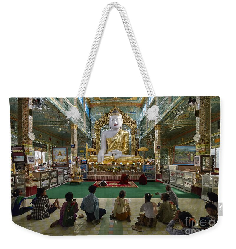 Sagain Weekender Tote Bag featuring the photograph faithful Buddhists praying at sitting Buddha in golden Ponnya Shin Pagoda by Juergen Ritterbach