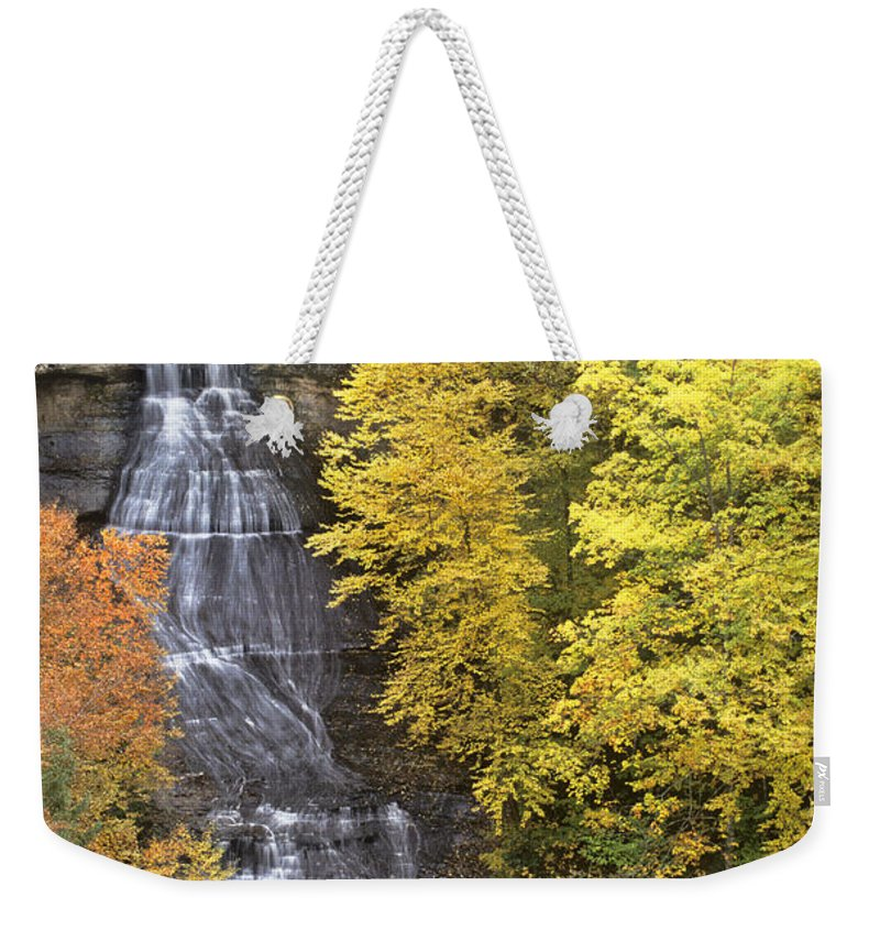Michigan Weekender Tote Bag featuring the photograph Fall Color Surrounds Chapel Falls On The Michigan Upper Peninsula by Dave Welling