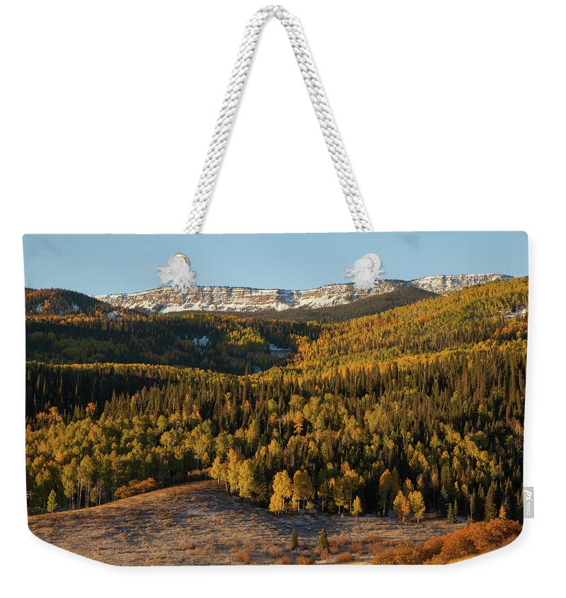 Tranquility Weekender Tote Bag featuring the photograph Fall Foliage And Snow-dusted Peaks by Karen Desjardin