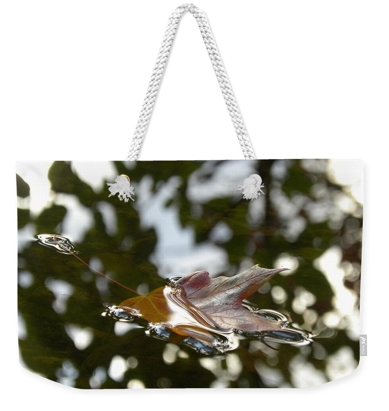 Leaf Weekender Tote Bag featuring the photograph Fall Leaf In Stream by Sheri Lauren