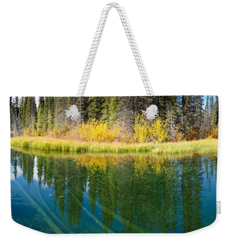 Authentic Weekender Tote Bag featuring the photograph Fall Sky Mirrored On Calm Clear Taiga Wetland Pond by Stephan Pietzko