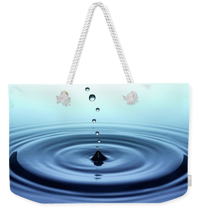 Water Surface Weekender Tote Bag featuring the photograph Falling Small Drops Of Water by Trout55