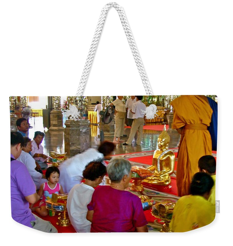Families Awaiting Teaching From A Monk At Wat Tha Sung Temple In Uthaithani Weekender Tote Bag featuring the photograph Families Awaiting Teaching From A Monk At Wat Tha Sung Temple In Uthaithani-thailand by Ruth Hager