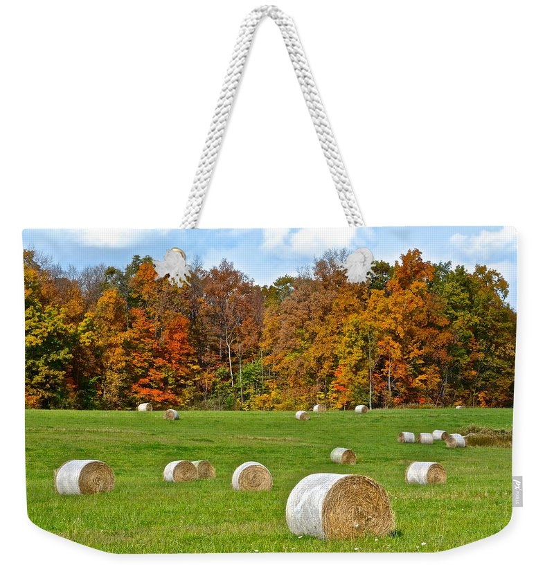 Farm Weekender Tote Bag featuring the photograph Farm Fresh Hay by Frozen in Time Fine Art Photography
