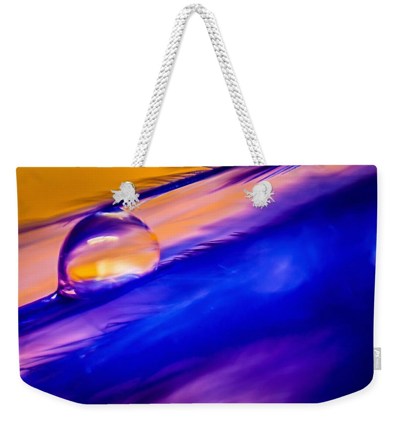 Feather Weekender Tote Bag featuring the photograph Feather Sunset by Lauri Novak