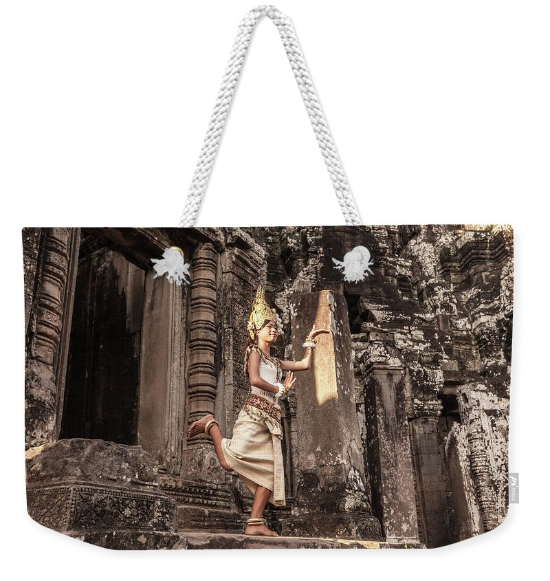 Hinduism Weekender Tote Bag featuring the photograph Female Apsara Dancer, Standing On One by Cultura Exclusive/gary Latham