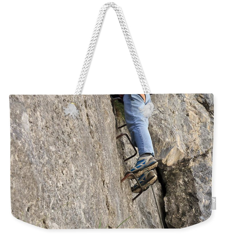 Active Weekender Tote Bag featuring the photograph female climber on Via Ferrata by Antonio Scarpi
