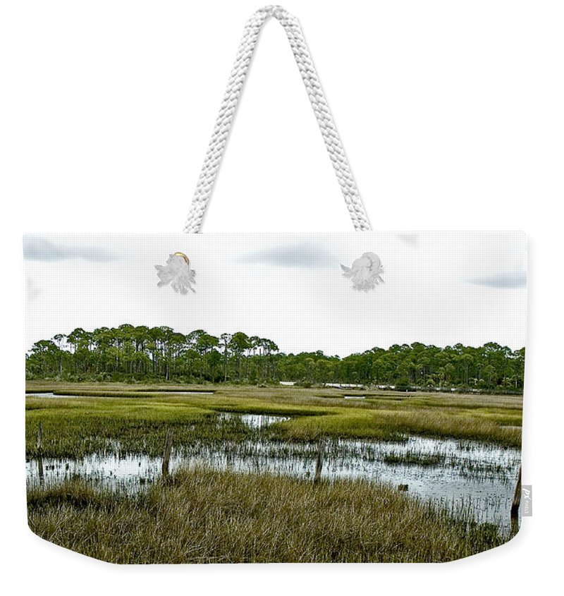 Salt Marsh Weekender Tote Bag featuring the photograph Fence Thru The Marsh by Norman Johnson